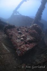 Tank on the nippo maru. by Jim Garland